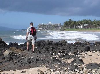 J walking on the coast